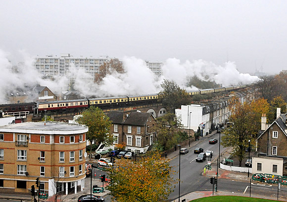 Tornado steam loco powers dramatically through Brixton