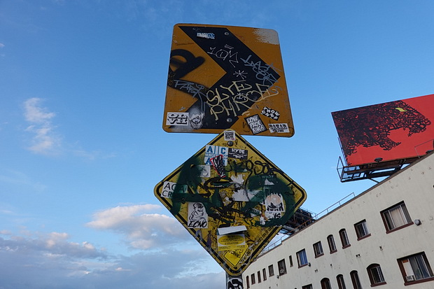 On tour in America: signs, street lights, wires and stop signs