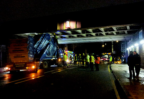 Bam! Skip lorry smashes into rail bridge on Barrington Road, Brixton