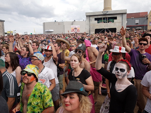Faces in the crowd: scenes from Boomtown's Town Centre, Boomtown Fair Festival 2015, Winchester, England, UK, August 2015