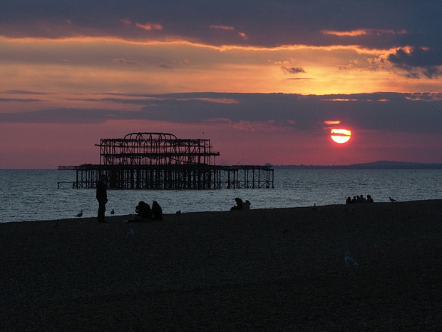 Brighton West Pier sunset - photos of the autumnal sun setting over the doomed Victorian pier, Sussex, England