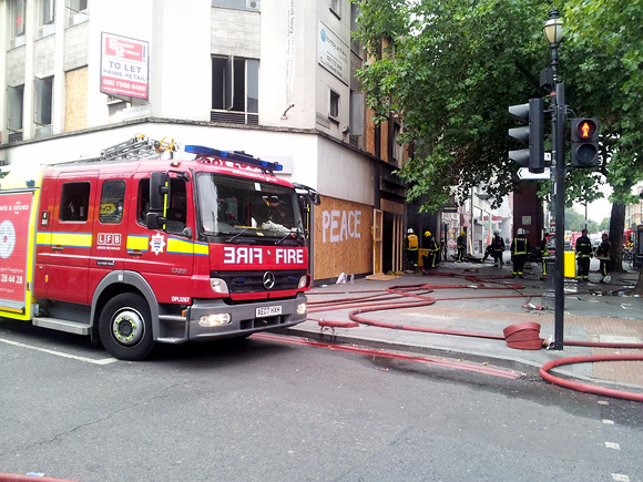 Brixton Footlocker fire smoulders on, tube station and shops still closed