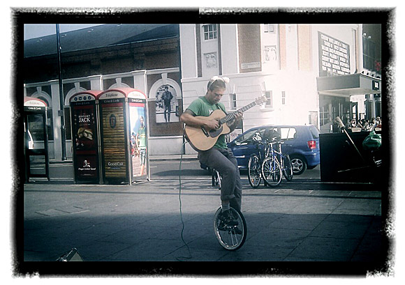 Brixton photos: unicycling busker, architecture and coffee