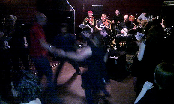 Drinking and stripping the willow at a Burns night ceilidh in Stockwell