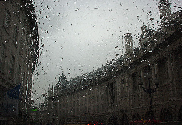 London in the rain, seen from a double decker bus