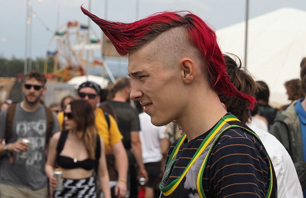 Faces of Boomtown Fair, music festival near Winchester, England, August 2014
