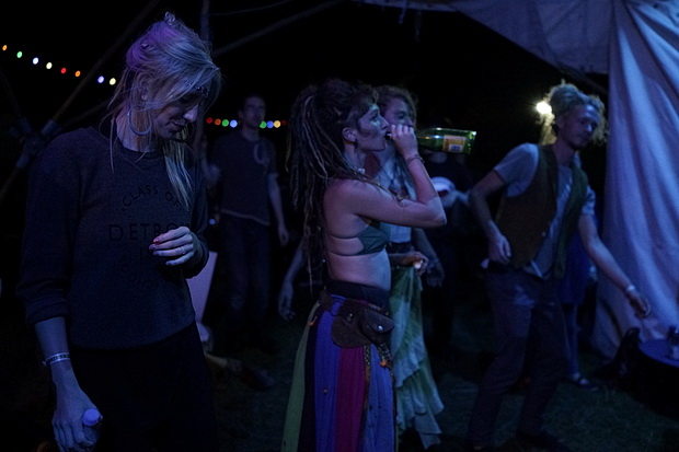 Green Gathering 2016 in photos. Night scenes: camp fires, upside down performers, bands and DJs, Chepstow, Wales, August 2016