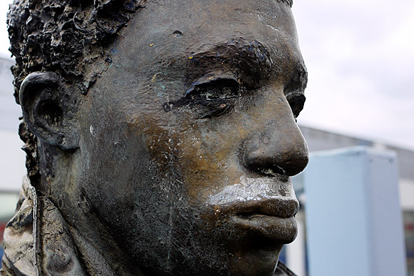 Human statues, Brixton railway station platform