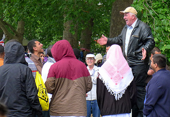 Shouting at Speakers' Corner, Hyde Park, on a wet Sunday