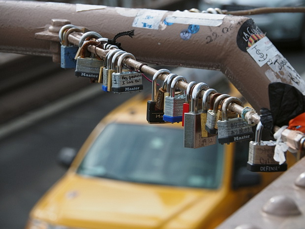 New York City is not pleased with the Love Padlock craze and orders them off Brooklyn Bridge, May 2014