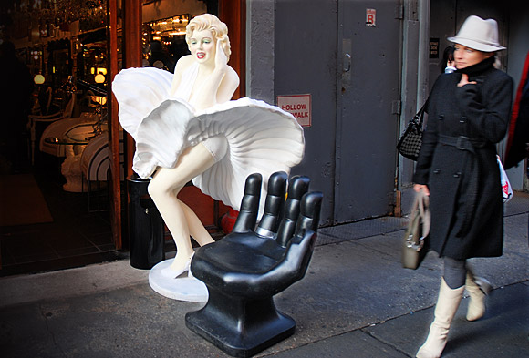 New York sidewalk street scene: Marilyn, a giant hand and a passer by