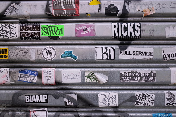 Photos of signs, stickers, graffiti and flags, New York
