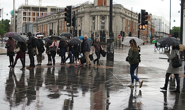 Umbrellas in June: a very rainy day in central London and Brixton