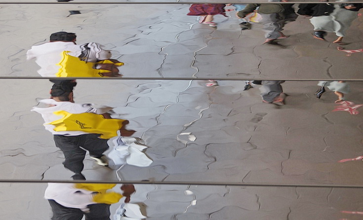 Oxford Street Reflections - abstract human shapes on a mirrored roof