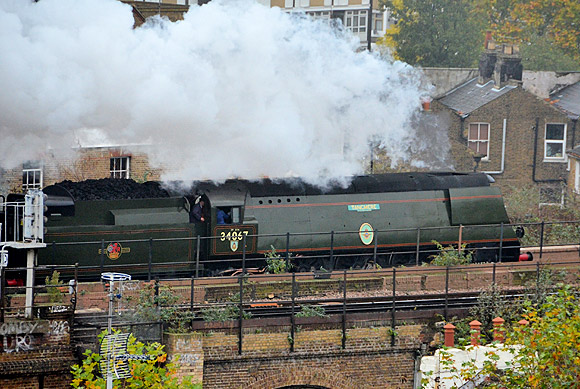 Christmas comes early as two steam locos pass in quick succession