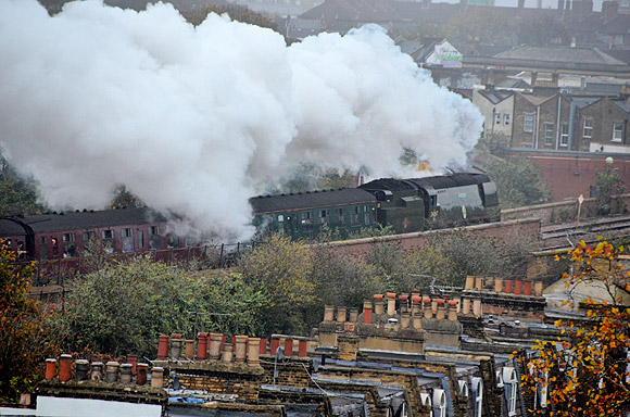 Christmas comes early in Brixton as two steam locos pass in quick succession
