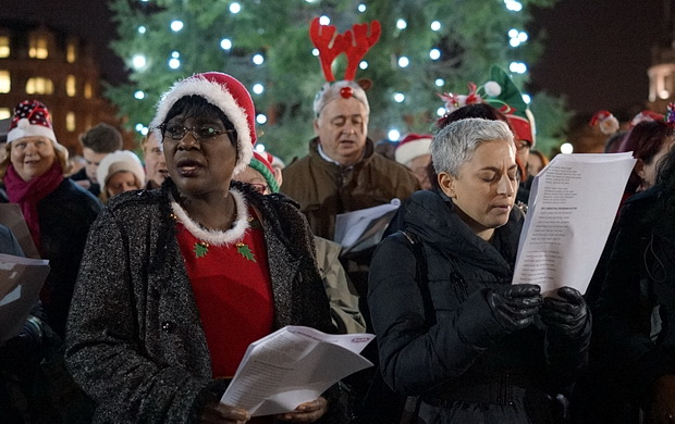 Choirs sing traditional Christmas carols in Trafalgar Square, London, December 2015