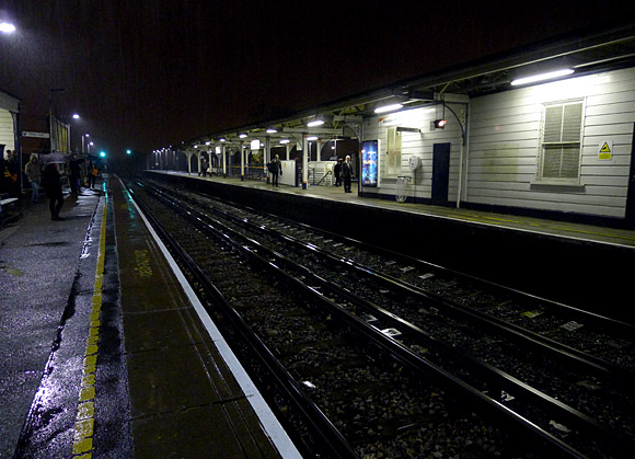 Wandsworth Town station in the early evening rain
