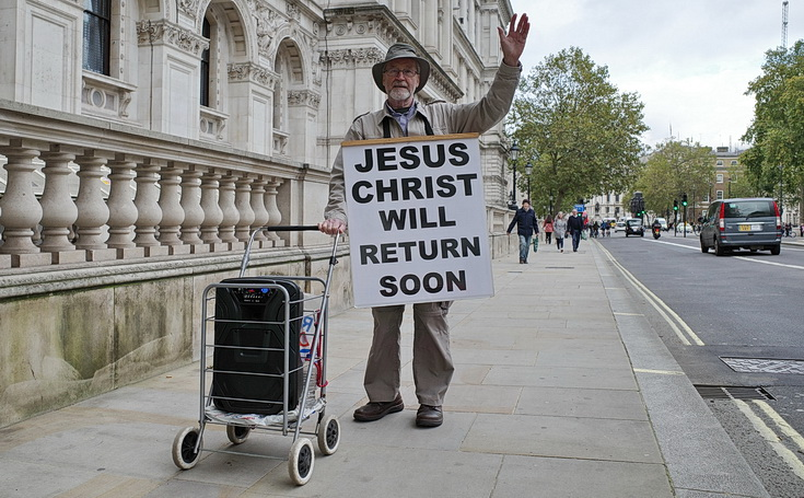 In photos: the arms-aloft street preacher with a speaker on wheels, Whitehall, London, Sat 17th Oct 2020