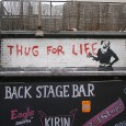 "Appearing opposite the Brixton Academy at the back of the Backstage Bar (on Astoria Walk, SW9) was this ""Thug For Life"" graffiti by Banksy."