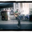 You've got to give him points for effort here. A unicycling, guitar playing busker wearing rabbit ears sings it out loud outside KFC in central Brixton.