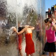 On a red hot August afternoon in 2004, kids are seen cooling off in the water feature in Cardiff bay (also known as the Torchwood Tower after its appearances  in the  BBC...