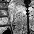 Photographed back in April 2002, here's a gas lamp man hard at work in Green Park, central London.
