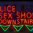 Amusingly damaged neon sign in the window of a Licensed Sex Shop, Charing Cross Road, W1.