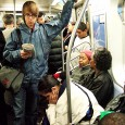 Busy scene on an early morning Manhattan subway. [More New York photos]
