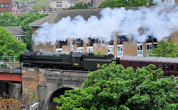 Britannia 7000 loco steams past Brixton