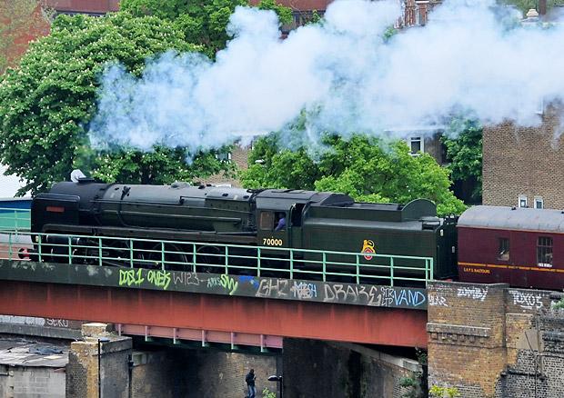 Britannia 7000 loco steams past Brixton