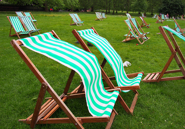 Empty deckchairs and a damp June afternoon in Green Park, London