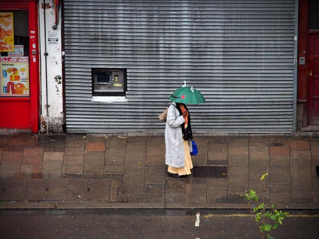 Happy brolly, sad weather - Brixton in the summer rain