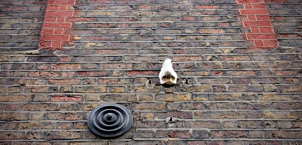 Looking up the nose of Meard Street, Soho, London