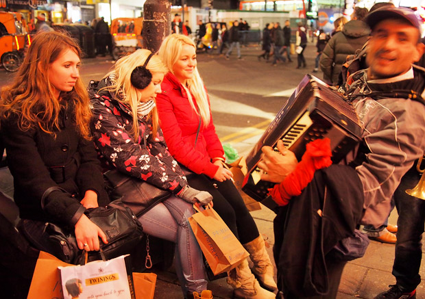 Pic of the day: accordion player tries to impress young girls. Pretty much fails