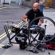 Seen bashing away in Hills Place near Oxford Circus on a drum kit mounted on a specially adapted bicycle is the busker known as Puncture Kit.