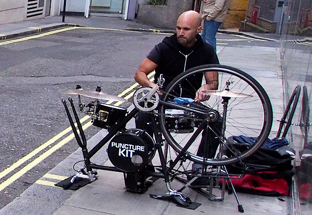 Puncture Kit busker plays on a drum kit made from a bicycle