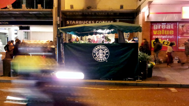 Tax-shirking Starbucks extend their branding onto Brixton flower stall