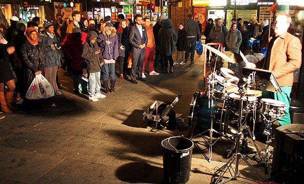 Busking drummer blasts out the beats in Brixton