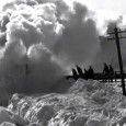 "The news reporters may scream ""Snow Chaos!' every time a few centimeters of the white stuff sprinkles down on Blighty, but it's looking pretty tame compared to this astonishing archive footage of a..."