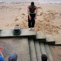 Practising parkour on the sandy beach of the River Thames, South Bank, London