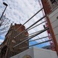 Houses held up by metal girders, Oxford Street, London