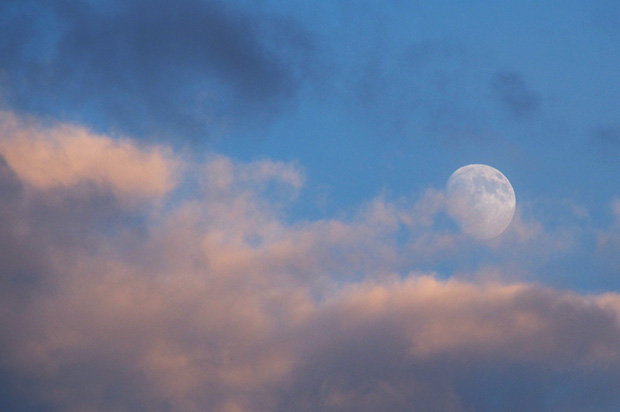 Moon in the evening sky over London