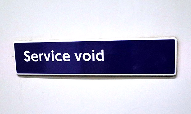 Two baffling London Underground signs