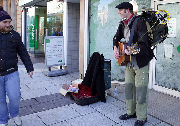 Things you don't see so much: a one man band plys his trade in Cardiff Queen Street