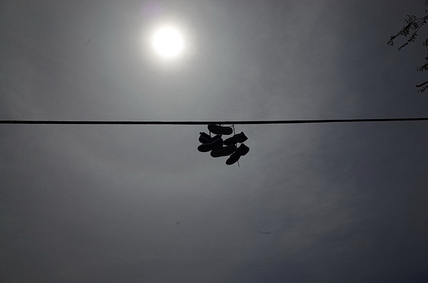 Sneakers dangling on the power lines of New York