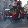 Exhaust fumes hang in the air as the Bus Cavalcade heads off towards Oxford Circus, London