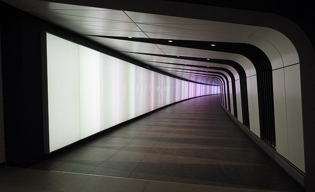Walking through the LED lightwall tunnel at Kings Cross station