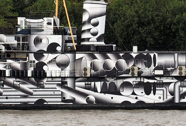 HMS President covered in dazzle camouflage on the River Thames, London