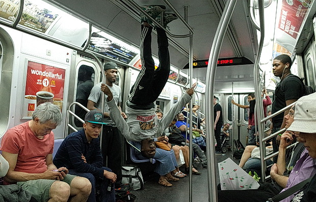 Don't look now, but there's dancers suspended from the subway roof: New York scenes